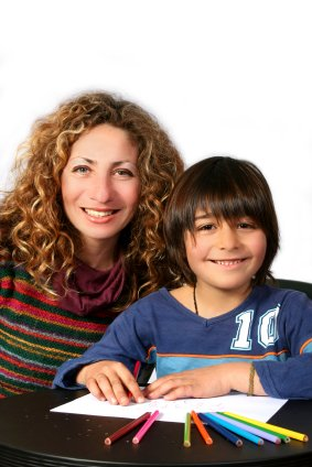 stay at home mom homeschooling her son