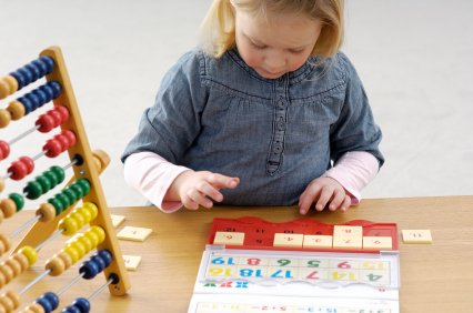 young girl playing a learning game
