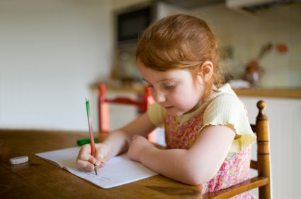 young girl busy with her homework