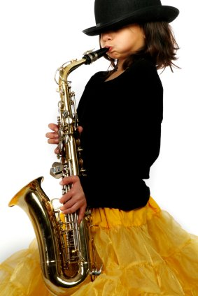 young girl playing saxaphone