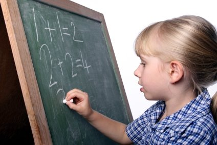 young girl doing her sums